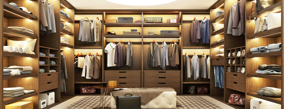 Large modern wardrobe with clothes with beautiful shelf lighting